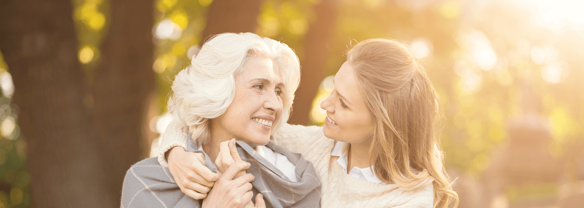 Planning for later life and long term care - Mother and daughter outside looking at each other