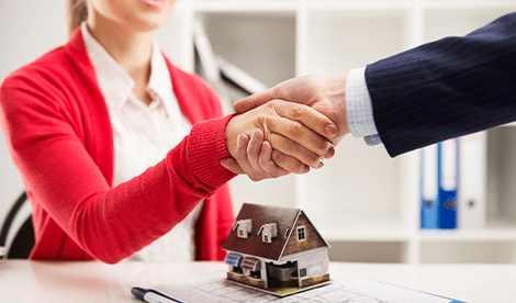 Changes to capital gains tax image - two people shaking hands over property