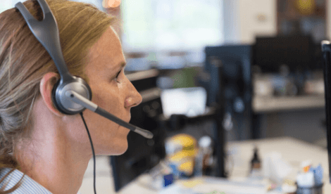 Woman with headset in call centre