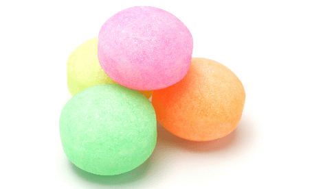 Colour mothballs in a pile