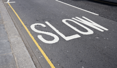 'SLOW' written on a UK road