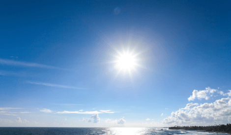 Blue sky with bright sun over sea - Future fund
