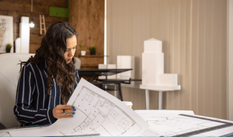 Female architect looking at planning docs for office space