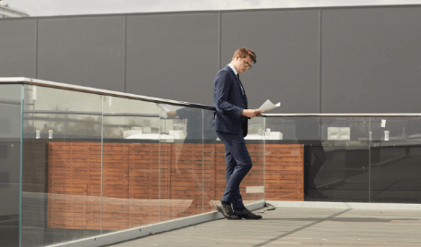 Male commercial property owner looking at documents outside