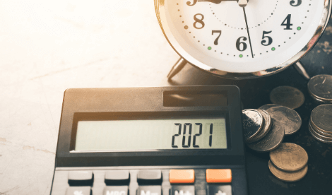 Classic alarm clock and calculator to signify HMRC self-assessment deadline