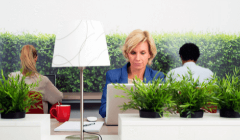 woman working on laptop in a greenery environment