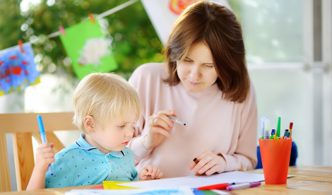 Carer drawing with child